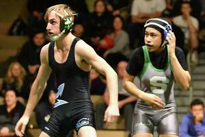 Shenendehowa's Maya Porter (132 lb), right, is seen wrestling with Columbia's Jacob Sovak during a match at Shenendehowa High School on Wednesday, Dec. 5, 2018 in Clifton Park, N.Y.  (Lori Van Buren/Times Union)