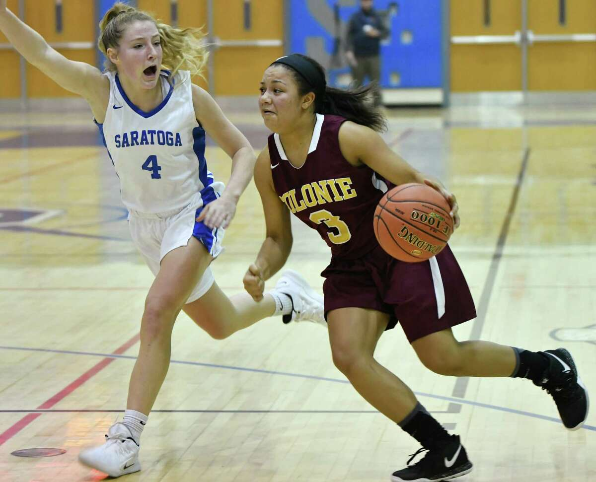 Colonie's Aliyah Wright drives to the basket guarded by Saratoga's Abby Ray during a basketball game on Tuesday, Dec. 4, 2018 in Saratoga Springs, N.Y. (Lori Van Buren/Times Union)