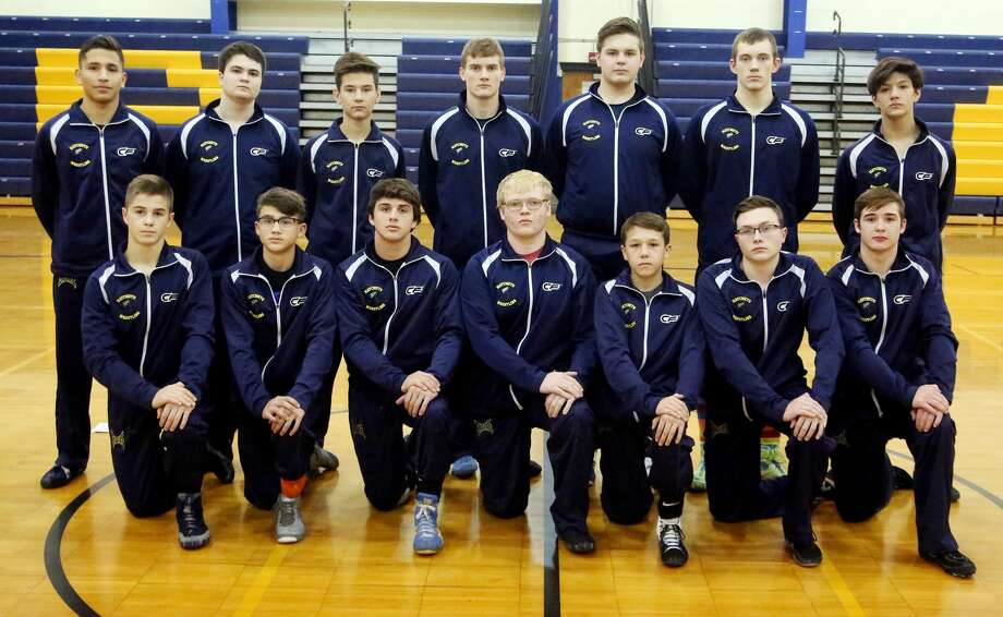 Members of the Bad Axe wrestling team are (front row from left) Sam Hass, Clark Wehner, Ryan Wehner, Devin Little, Jordan Osentoski, Sean Meyers and Ben Thompson (back row) Juan Castrillon, Aaron Boone, Gavin Tetreau, Carson Affer, Ben Shuart, Cody Bailey and Ryan Sanchez. Photo: Paul P. Adams/Huron Daily Tribune