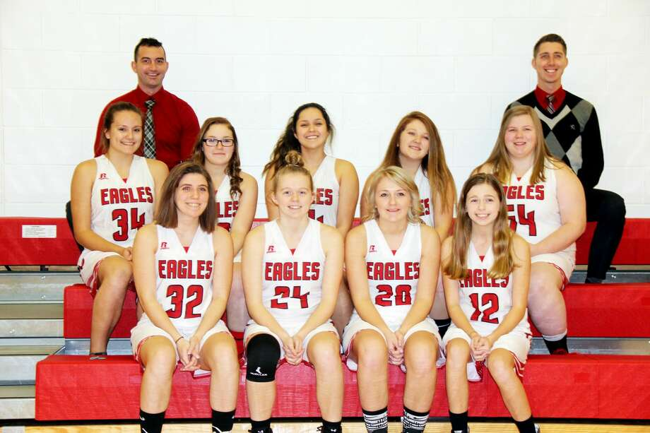 Members of the Caseville varsity girls basketball team are (front row from left) Timarie Kildow, Kaylin Ewald, Dezera Breismiester, and Adrian Ewald (middle row) Emma Hopkins, Chelsey Breismiester, Jessica Nugent, Tyonna Ontiveros and Natalie Campis (back row) head coach Joey Sancrant and assistant coach Michael Goforth. Photo: Mike Gallagher/Huron Daily Tribune