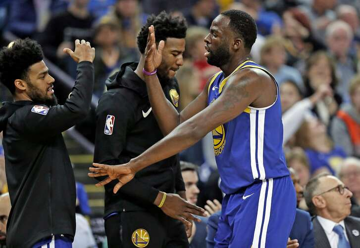 Golden State Warriors' Draymond Green returns to bench in 1st quarter against Minnesota Timberwolves during NBA game at Oracle Arena in Oakland, Calif. on Monday, December 10, 2018.