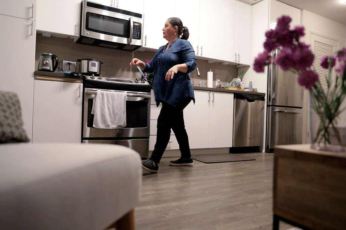 Lourdes Dobarganes cleans the studio apartment of one of her clients in San Francisco, Calif., on Monday, December 10, 2018. Dobarganes is looking into using Alia, a new service for people who clean houses to have their employers chip in to provide some benefits for them, such as paid time off or life insurance.