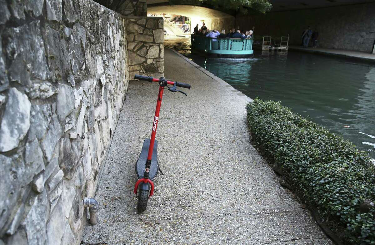 A scooter is parked on the River Walk, where riding them is banned. The city says it will be stepping up enforcement of its rules about parking scooters, such as parking.