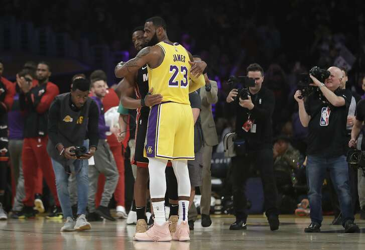 Los Angeles Lakers forward LeBron James (23) hugs ex teammate and current Miami Heat player Dwyane Wade during the first half of an NBA basketball game Monday, Dec. 10, 2018, in Los Angeles. (AP Photo/Marcio Jose Sanchez)