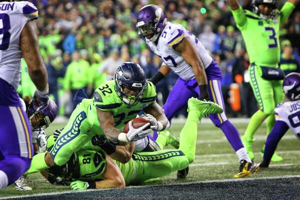 Seahawks running back Chris Carson dives for a touchdown during the second half of Seattle's game against the Minnesota Vikings at CenturyLink Field, Dec. 10, 2018.