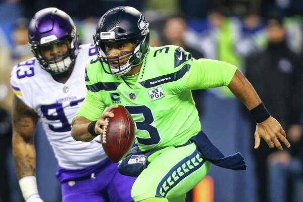 Seahawks quarterback Russell Wilson scrambles for yards during the first half of Seattle's game against the Minnesota Vikings at CenturyLink Field, Dec. 10, 2018.