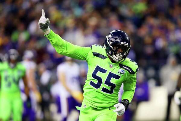 Seahawks defensive lineman Frank Clark celebrates his 3rd down sack of Vikings quarterback Kirk Cousins during the first half of Seattle's game against the Minnesota Vikings at CenturyLink Field, Dec. 10, 2018.