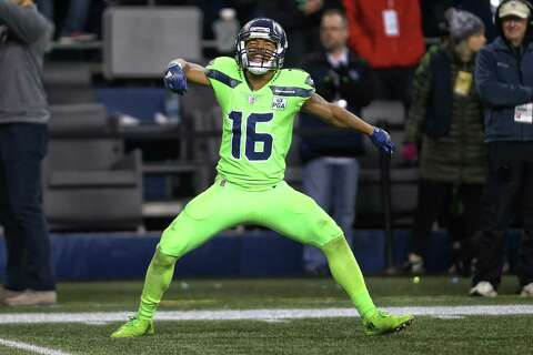 c46387a8b Seahawks quarterback Russell Wilson had a perfect passer rating when  targeting Lockett in the regular season