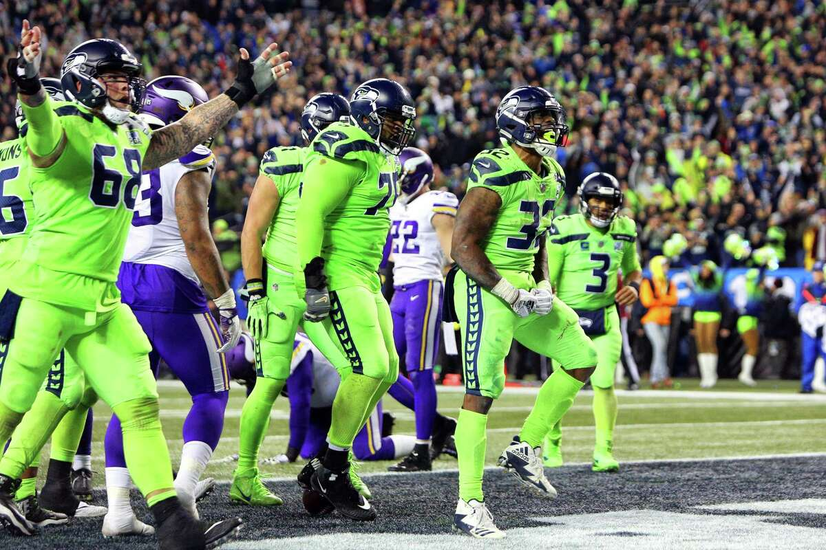 Seahawks running back Chris Carson celebrates his touchdown during the second half of Seattle's game against the Minnesota Vikings at CenturyLink Field, Dec. 10, 2018.