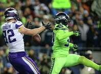 Seahawks safety Bradley McDougald, right, breaks up a pass in the end zone intended for Vikings tight end Kyle Rudolph during the second half of Seattle's game against the Minnesota Vikings at CenturyLink Field, Dec. 10, 2018.