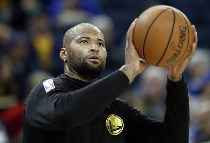 Golden State Warriors' DeMarcus Cousins works out before Warriors play Minnesota Timberwolves during NBA game at Oracle Arena in Oakland, Calif. on Monday, December 10, 2018.