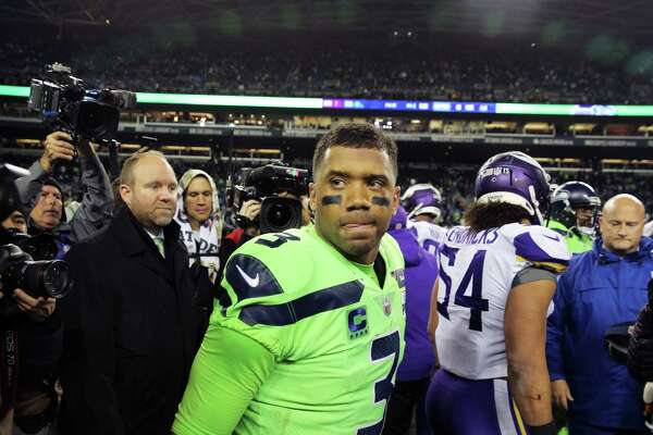 Seahawks quarterback Russell Wilson walks through the crowd after Seattle's 21-7 victory against the Minnesota Vikings at CenturyLink Field, Dec. 10, 2018.