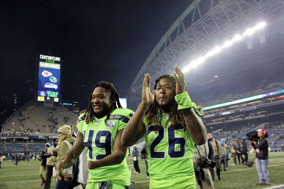 Twins Shaquem Griffin, left, and Shaquill Griffin head off field after Seattle's game against the Minnesota Vikings at CenturyLink Field, Dec. 10, 2018.