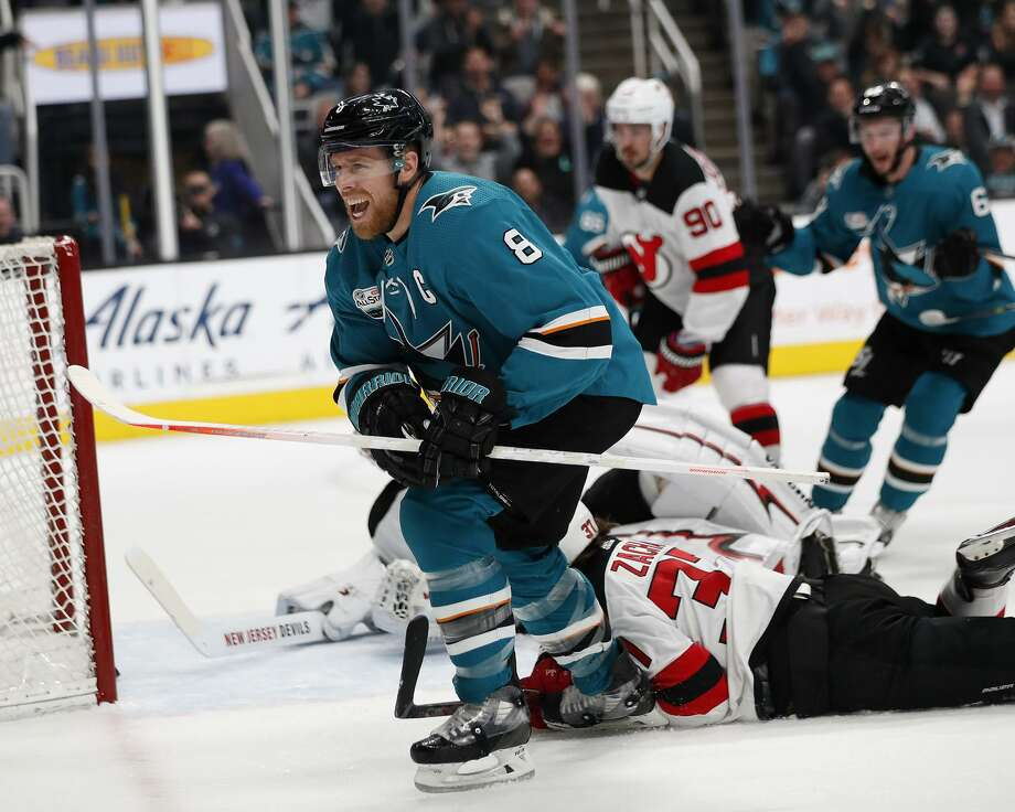 San Jose Sharks' Joe Pavelski (8) celebrates after scoring goal against New Jersey Devils goaltender Keith Kinkaid in the first period of an NHL hockey game in San Jose, Calif., Monday, Dec. 10, 2018. Photo: Josie Lepe / Associated Press / Copyright 2018 The Associated Press. All rights reserved.