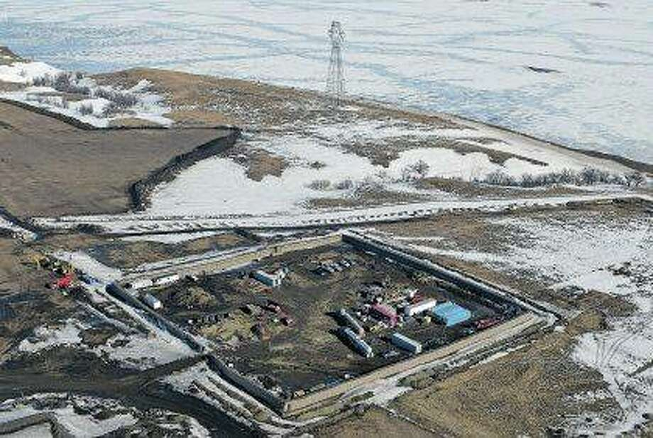 The final phase of the Dakota Access Pipeline near the Missouri River took place with boring equipment routing the pipeline underground and across Lake Oahe to connect with the existing pipeline in Emmons County in Cannon Ball, North Dakota. All four Native American tribes in the Dakotas that are fighting the oil pipeline in court are seeking to challenge the recent conclusion of federal officials that a spill would not greatly affect tribal populations. At the heart of the matter is a report from the Army Corps of Engineers detailing its conclusion. The federal judge overseeing the case has scheduled a status conference in Washington on Wednesday to determine how to proceed. Photo: Tom Stromme | Bismarck Tribune (AP)