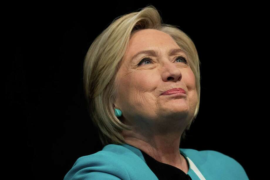"""Former U.S. Secretary of State Hillary Clinton signs copies of her new book """"What Happened"""" during a book signing event at Barnes and Noble bookstore September 12, 2017 in New York City. Photo: Drew Angerer / 2017 Getty Images"""