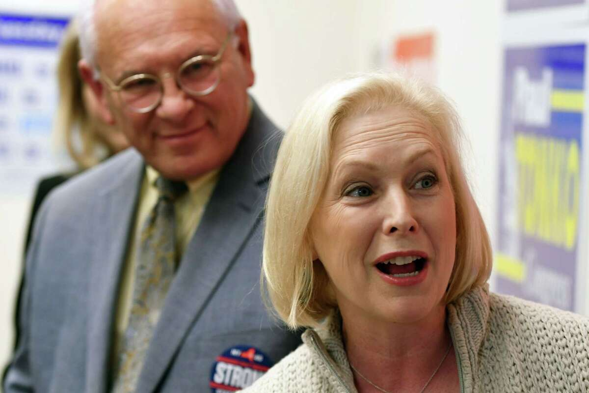 U.S. Rep. Paul Tonko, left, and Sen. Kirsten Gillibrand, right, speak to volunteers at the Albany Democratic Committee headquarters on Monday, Nov. 5, 2018, in Albany, N.Y. (Will Waldron/Times Union)