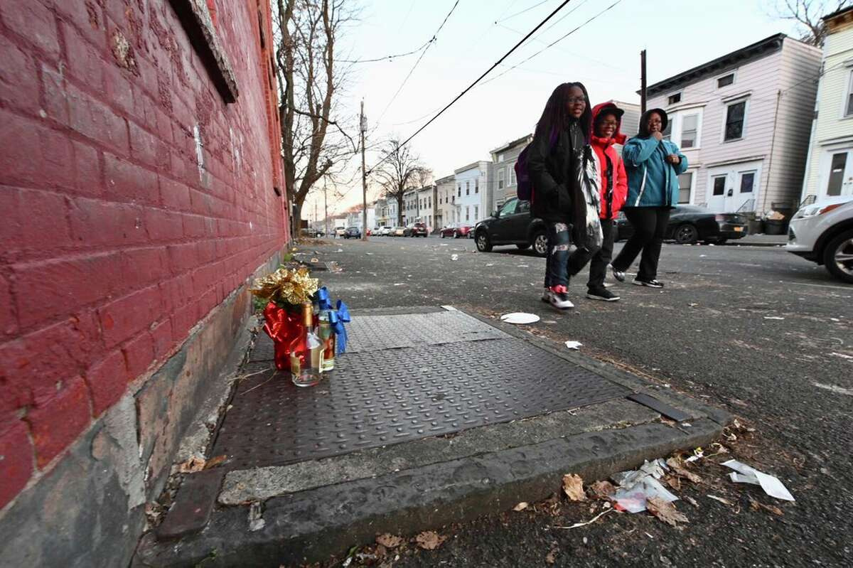 A memorial on Second Street side of the Delaware Grocery has already sprung up to recognize the death of a 28-year-old man who was shot and killed around the corner Monday night.
