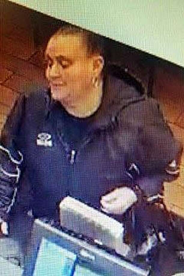 Police and a Milford bakery are asking the public's help to ID a woman who stole the tips jar from the business. Scratch Bakery on Broad Street said the theft happened around 2 p.m. on Sunday, Dec. 9, 2018. Photo: /