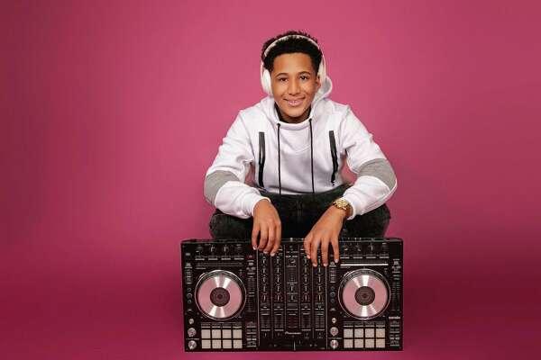 "Omar ""DJ BamBam"" Ennis poses for a portrait at Optik21 Studio in Bridgeport, CT"