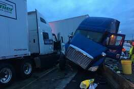 Trooper Johnna Batiste tweeted these photos of the crash involving two semi-trailer tractors.
