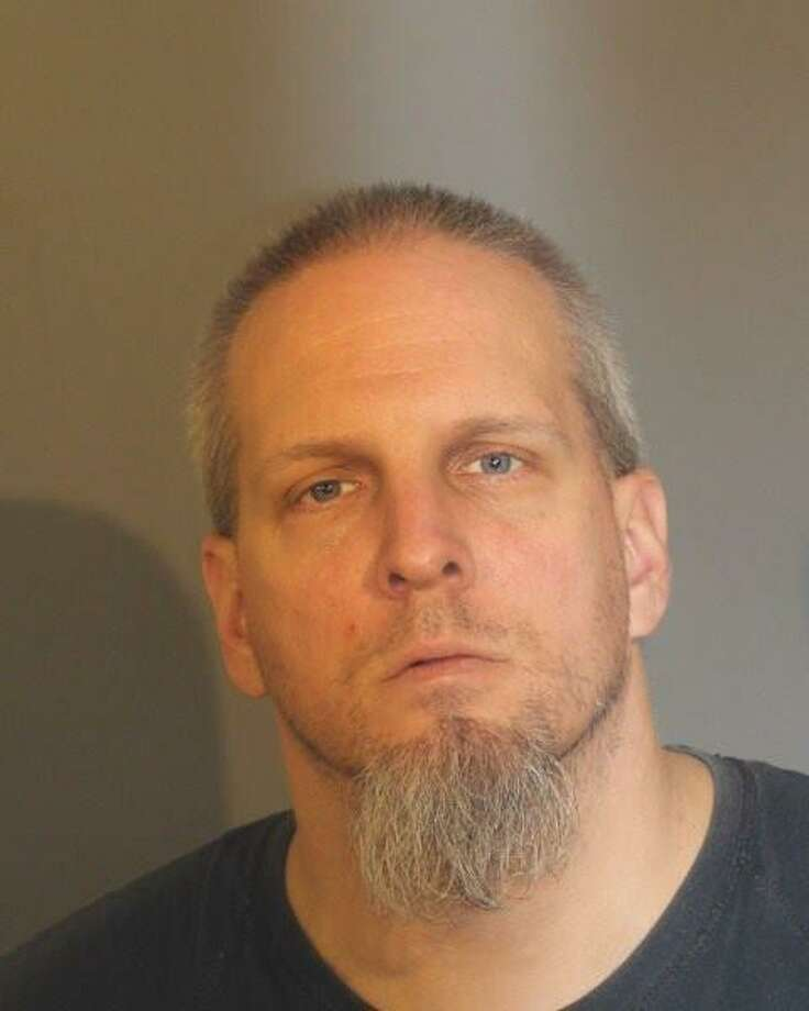 Edmund Paris, 39, was arrested by Danbury police on Friday and is charged with nine counts of sexual assault, sexual contact with a minor and risk of injury to a minor. Photo: Submitted Photo / Danbury Police Department