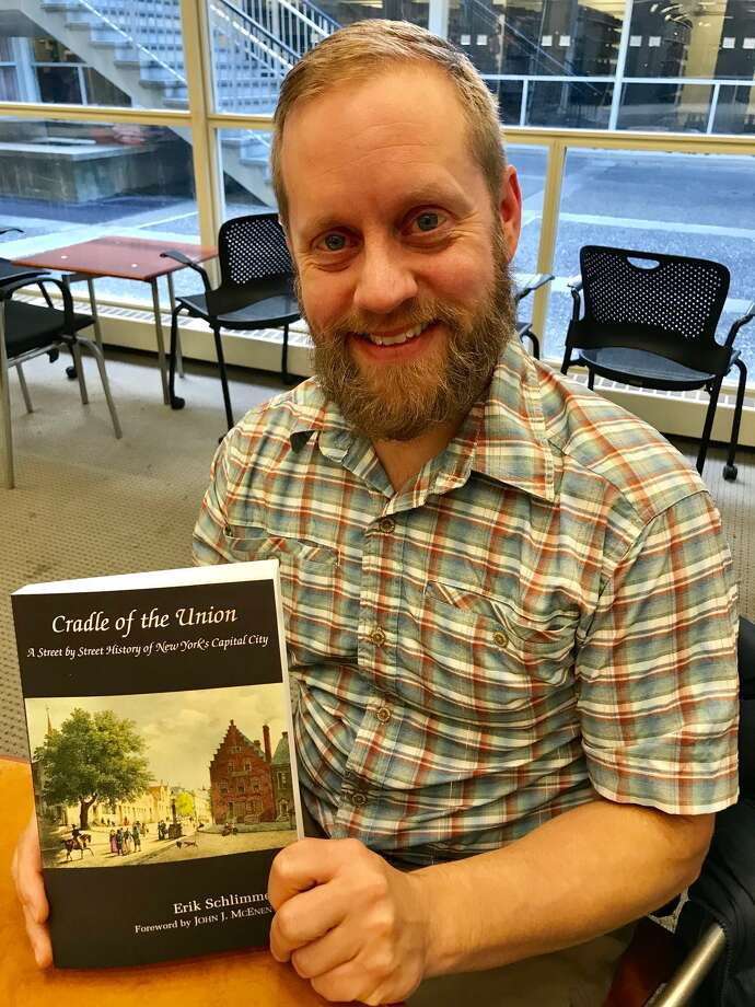 "Author Erik Schlimmer with his new book, ""Cradle of the Union: A Street by Street History of New York's Capital City."" (Paul Grondahl / Times Union);"