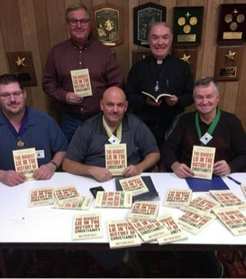 Pictured are (front row), Don Bredow Jr., Brian Boyce and Steve Braun; and (back row), Phil Peyerk and Fr. Craig Carolan. (Submitted Photo)