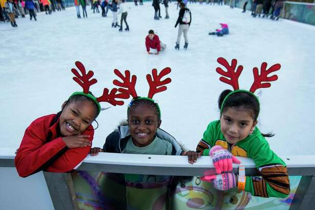Children participate in the 3rd annual Year Of Joy Holiday Ice Skating Party at the ICE powered by Green Mountain Energy at Discovery Green in downtown Houston, Monday, Dec. 10, 2018.