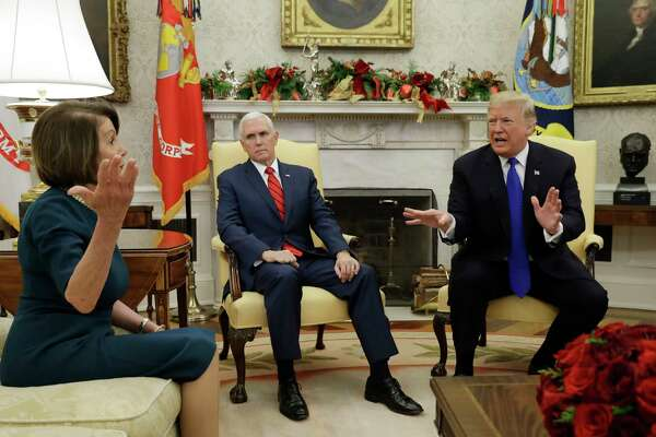 President Donald Trump and Vice President Mike Pence, meet with House Minority Leader Nancy Pelosi, D-Calif., left, and Senate Minority Leader Chuck Schumer, D-N.Y., not shown, in the Oval Office of the White House, Tuesday, Dec. 11, 2018, in Washington.