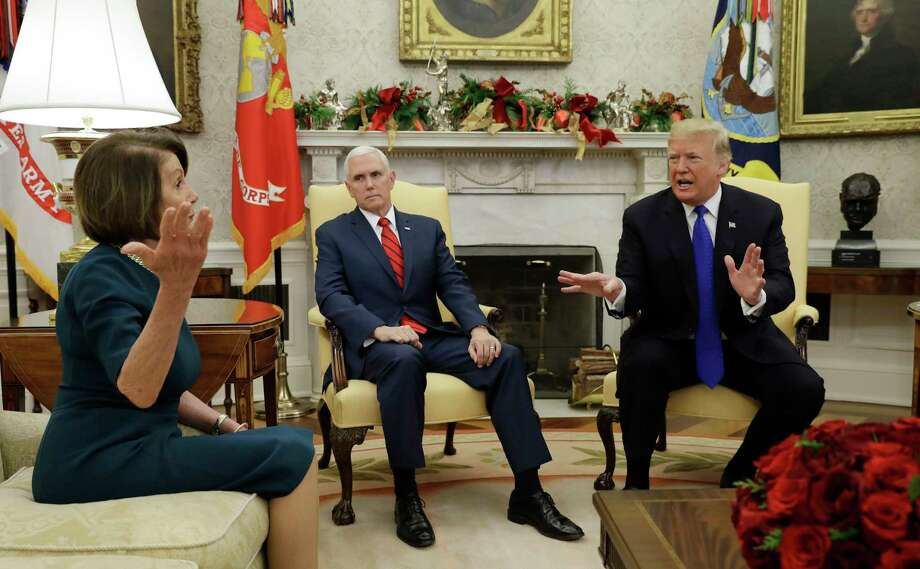 President Donald Trump and Vice President Mike Pence, meet with House Minority Leader Nancy Pelosi, D-Calif., left, and Senate Minority Leader Chuck Schumer, D-N.Y., not shown, in the Oval Office of the White House, Tuesday, Dec. 11, 2018, in Washington. Photo: Evan Vucci, AP / Copyright 2018 The Associated Press. All rights reserved.