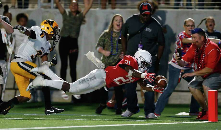 Fort Bend Marshall safety Drew Conley (left) attemps to stop Manvel's Ladarious Owens from scoring in a game on September 21, 2018. Conley was shot and killed Monday night.