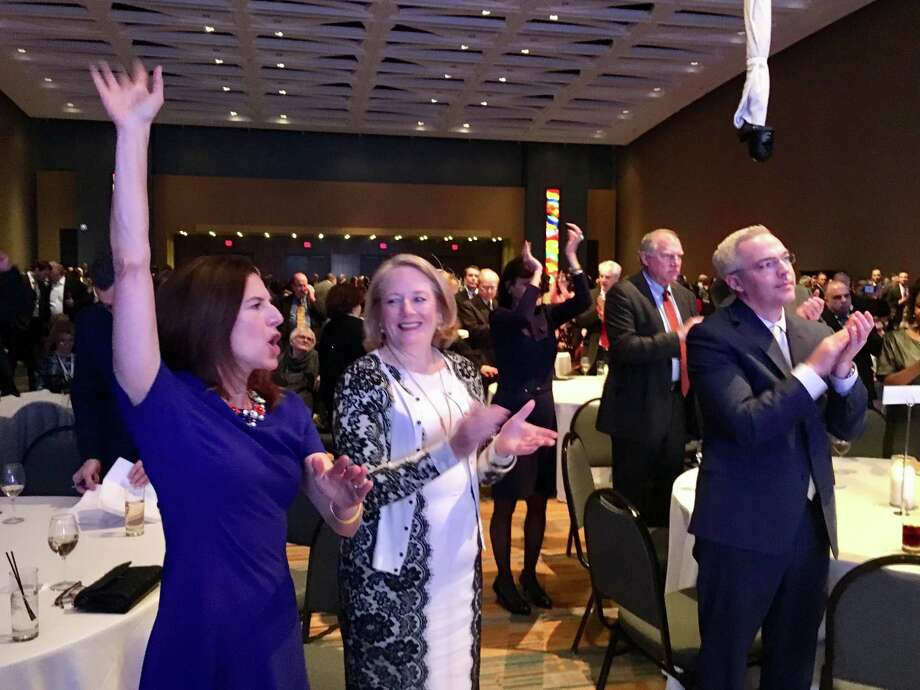 Lt. Gov.-elect Susan Bysiewicz, left, reacts to a shout out from Gov.-elect Ned Lamont Monday night at a Democratic Party celebration in Hartford. Others shown are from left Cathy Malloy, Attorney General George Jepsen and Ryan Drajewicz, Lamont's chief of staff. Many people at the party angled for state jobs. Photo: Dan Haar / Hearst Connecticut Media