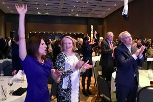 Lt. Gov.-elect Susan Bysiewicz, left, reacts to a shout out from Gov.-elect Ned Lamont Monday night at a Democratic Party celebration in Hartford. Others shown are from left Cathy Malloy, Attorney General George Jepsen and Ryan Drajewicz, Lamont's chief of staff. Many people at the party angled for state jobs.