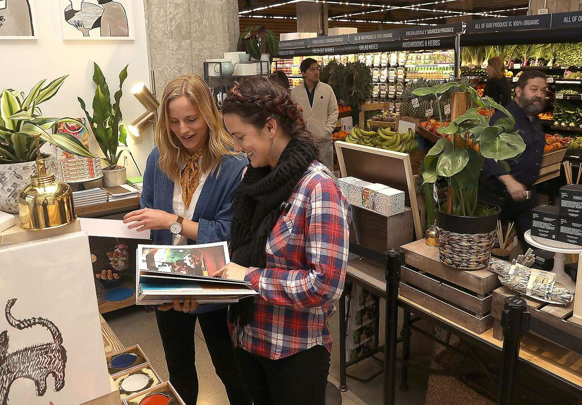 Lucy Melling (left) and Lindsay Brown (middle) both from San Francisco, browse a gift store at The Market on Friday, Dec. 7, 2018, in San Francisco, Calif.