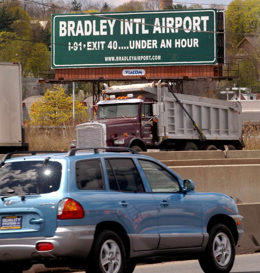 (ms0117)CITY-4/28/04-MS-BRADLEY SIGN-A sign along I-95 near the New Haven /East Haven line, states that Bradley International Airport can be reached in less than 1 hour.   lMelanie Stengel/Register Photo: /