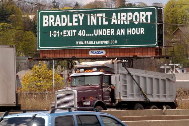 (ms0117)CITY-4/28/04-MS-BRADLEY SIGN-A sign along I-95 near the New Haven /East Haven line, states that Bradley International Airport can be reached in less than 1 hour. lMelanie Stengel/Register