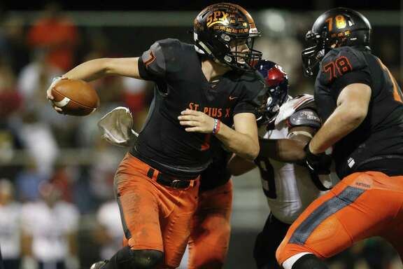 St. Pius X quarterback Grant Gunnell (7) is forced to scramble in the second half during the high school football game between the Bishop Dunne Falcons and the St. Pius X Panthers at Kubiak Stadium in Houston on Friday, Oct. 5.