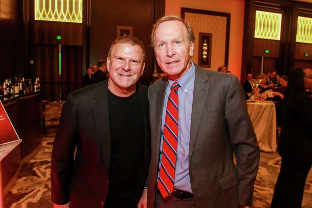 "EMBARGOED FOR SOCIETY REPORTER UNTIL DEC. 11 Tilman Fertitta, left, and Neal Bush at the ""Answering the Call"" cocktail party. Saint Bernard Project is one of the four organizations who received funding from JJ Watt Foundation's Hurricane Harvey fundraising."