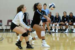 Alexis DaCosta (11) of Paetow digs for a ball in the second set of a high school volleyball match between the Paetow Panthers and the Kempner Cougars during the 2018 Katy / Cy-Fair Volleyball Classic on August 11, 2018 at Cinco Ranch High School, Katy, TX.