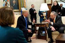 Presumptive Speaker, House Minority Leader Nancy Pelosi (D-CA) (L) listens while US President Donald Trump (C) and Senate Minority Leader Charles E. Schumer (D-NY) argue before a meeting at the White House December 11, 2018 in Washington, DC.
