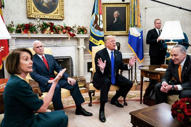 President Donald Trump debates with House Minority Leader Nancy Pelosi, D-Calif., left, and Senate Minority Leader Chuck Schumer, D-N.Y., right, as Vice President Mike Pence listens during a meeting in the Oval Office of White House on Dec. 11, 2018 in Washington, D.C.