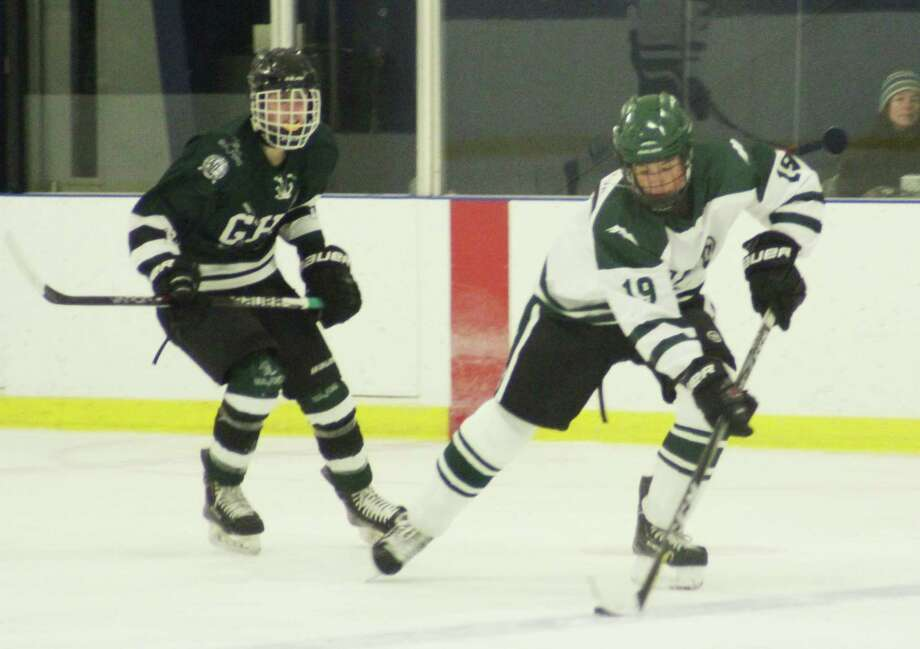 Spectrum/New Milford High School hockey team recently played home against Guilford. Unfortunately, the Green Wave lost the Jan. 10, 2018 game 9-4. Above, junior Evan Golembeske skates the puck up the ice past the Guilford defense to get the first goal for New Milford. Courtesy of Katie Alzapiedi Photo: Contributed Photo / Contributed Photo / The News-Times Contributed