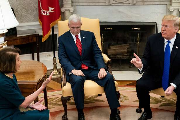 US Vice President Mike Pence (C) listens as presumptive Speaker, House Minority Leader Nancy Pelosi (D-CA), and US President Donald Trump (R) speak while making statements to the press before a meeting at the White House December 11, 2018 in Washington, DC.