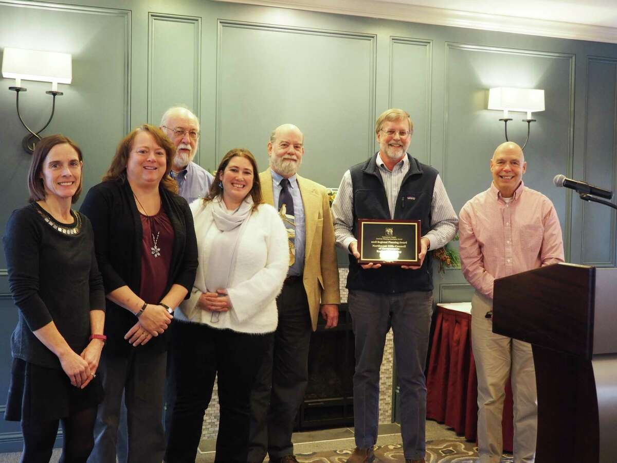 The Northwest Hills Council of Governments has received the 2018 Regional Planning Award from the CT Chapter of the American Planning Association for the creation of their interactive regional trail map. COG Executive Director Rick Lynn and representatives from the COGs Regional Trail Map Committee accepted the award at a recent award ceremony in Middletown. From left are Connie Manes, Stacy Deming, Dan McGuinness, Rista Malanca, Craig Nelson, Rick Lynn, and Marty Connor.
