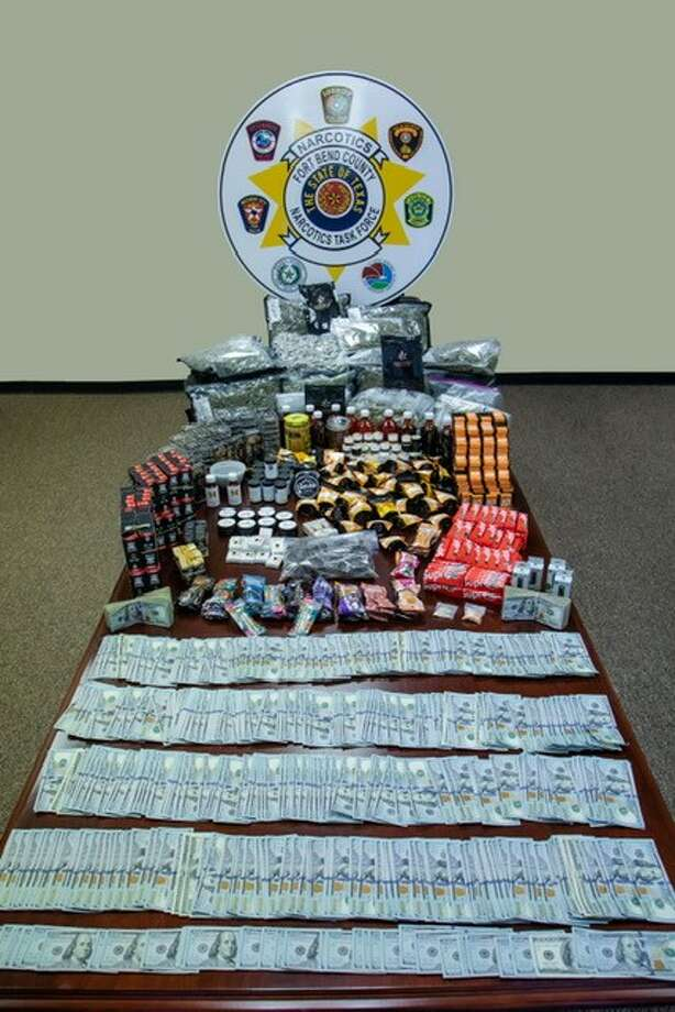 The Fort Bend County Sheriff's Office shows off a haul of drugs, paraphernalia and money seized during a recent drug bust. Photo: Fort Bend County Sheriff's Office
