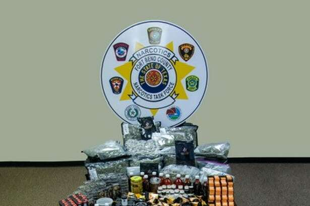 The Fort Bend County Sheriff's Office shows off a haul of drugs, paraphernalia and money seized during a recent drug bust.