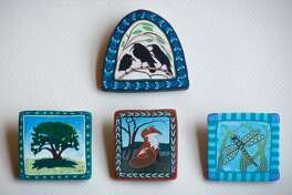 The Washington Art Association is presenting its annual holiday sale through Dec. 24. The event will feature handcrafted gifts by local artisans, including Karin Noyes, whose pins and pendants made from polymer clay are shown above. The sale will be open Wednesdays through Sundays from 10 a.m. to 4 p.m. through Dec. 24 at the association located in Bryan Plaza.