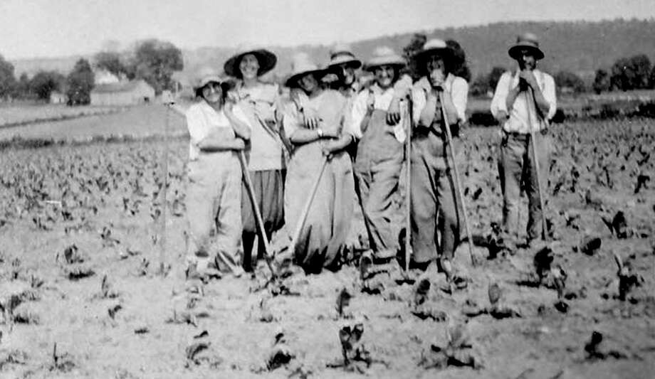 "New Milford and surrounding towns have a rich farming history. For the opportunity to be photographed, good-humored farm folks in 1918 take a break from their labors in a field along Park Lane (now Route 202) in New Milford. If you have a ""Way Back When"" photograph you'd like to share, contact Deborah Rose at drose@newstimes.com or 860-355-7324. Photo: Courtesy Of Bette Lou Emmons / The News-Times Contributed"
