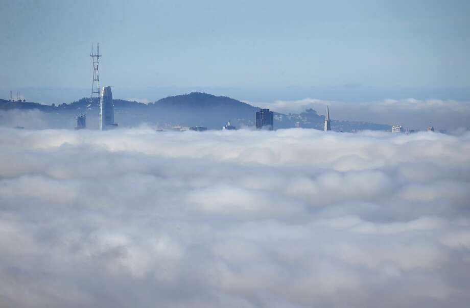 The San Francisco skyline rises above a low fog bank shrouding the bay as seen from the Lawrence Hall of Science in Berkeley, Calif. on Tuesday, Dec. 11, 2018. Photo: Paul Chinn, The Chronicle